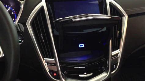 hidden compartment motorized lid  cadillac srx