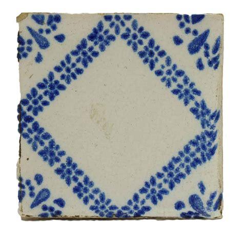 single blue white decorative tile olde things