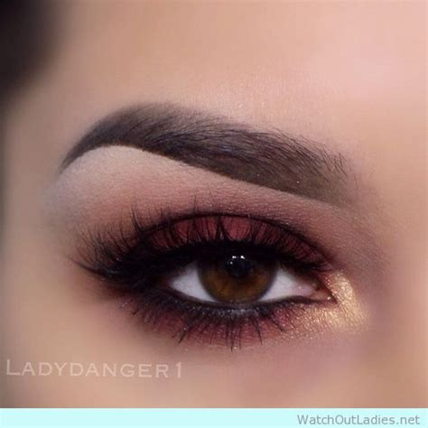 gold  burgundy eye makeup  black eyeliner details