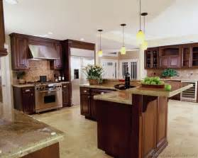 Luxury Kitchen Islands A Luxury Kitchen With Cherry Cabinets And A Large Island