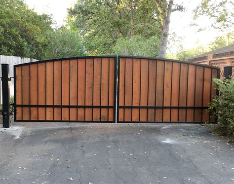 Dual Wrought Iron And Wood Driveway Gate With Posts And Hinges