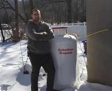gas company ends   showdown   yanks propane tank