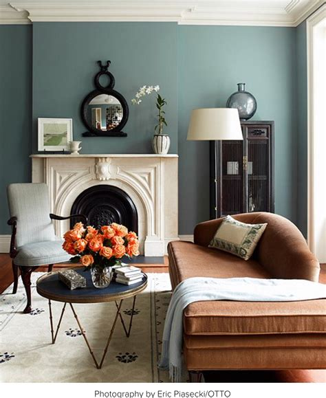 muted teal walls with an orange velvet chaise coral