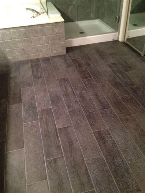 Bathroom floor  6x24 tiles charcoal gray. Look like wood