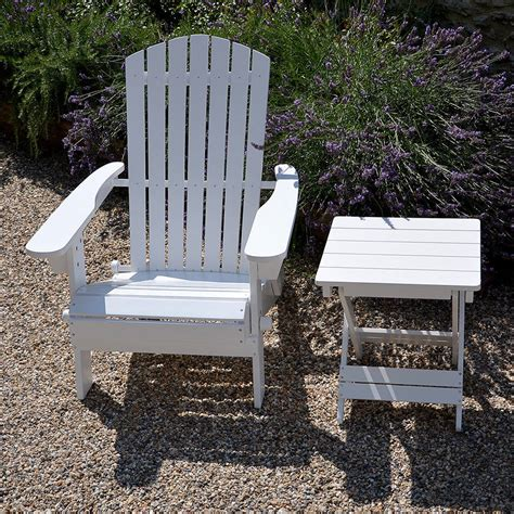 adirondack folding hardwood chair painted white by plant