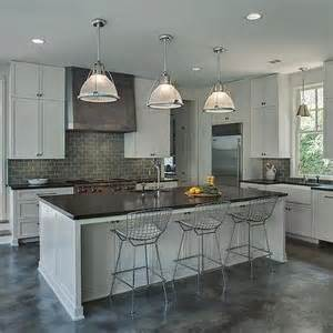 gray kitchen island with gray linen tufted counter stools