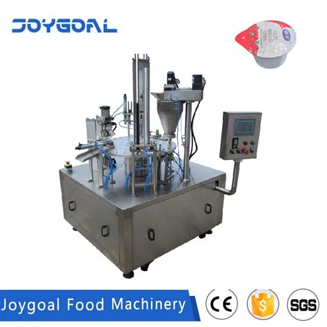 disposable smoothie plastic film rolled ifill volumetric cup filling sealing machine  dubai