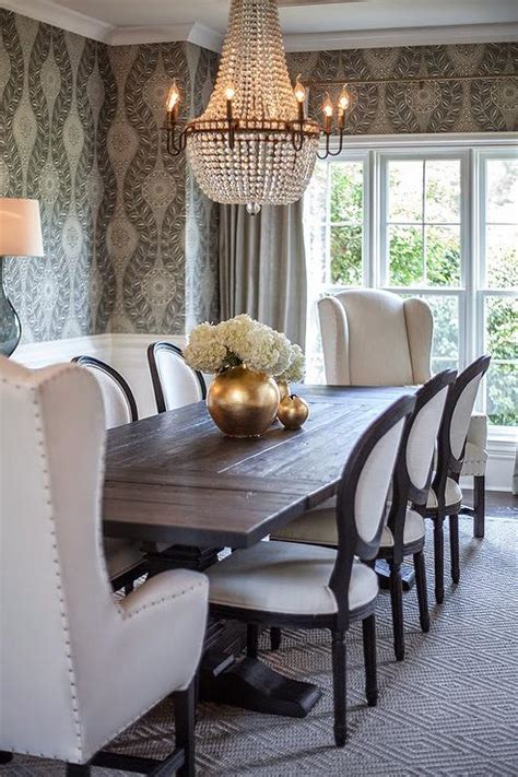 sophisticated gray dining room features oval dining