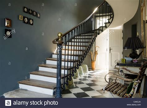 hallway with checked floor tiles oak wood staircase with