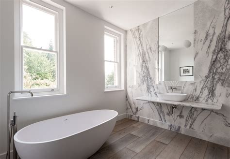 large white wall mirror bathroom of the week in a dramatic marble