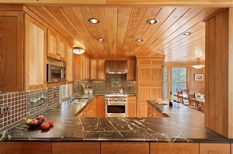 cozy cabin retreat combines warmth  wood   bright open interior