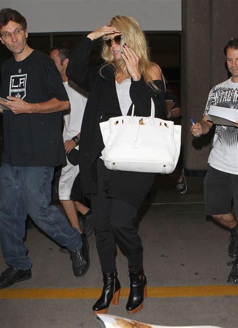 pamela anderson handbags  stylebistro