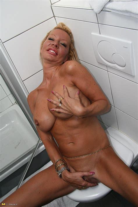 blonde milf savanna teases in the bathroom milf fox