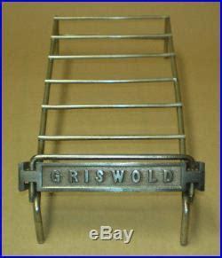 vintage griswold store display rack  cast iron skillets