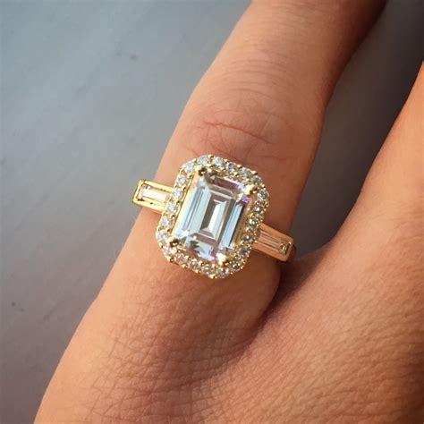 emerald cut diamond engagement ring with pave diamond halo