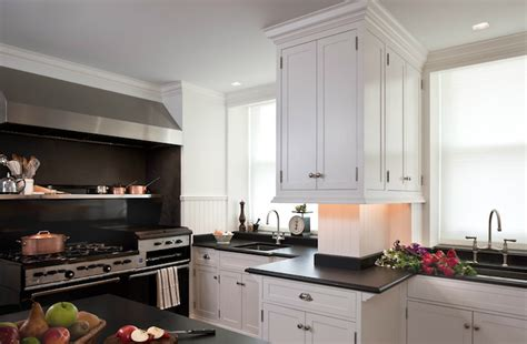 white cabinets  black countertops transitional