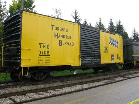 Yellow Th And B Train Car In St Jacobs, Ontario.jpg
