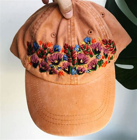 embroidered hats adorned  beautiful blooms  lexi mire