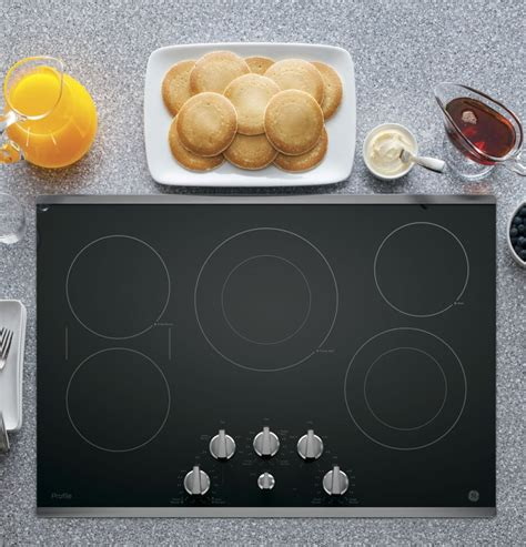 ge cooktop knobs ge pp7030sjss 30 inch electric cooktop with 5 radiant 1201