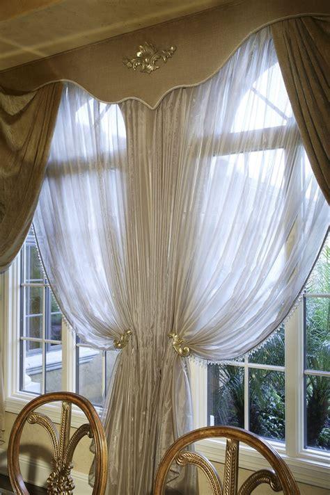 beautiful window treatments  gold drapes