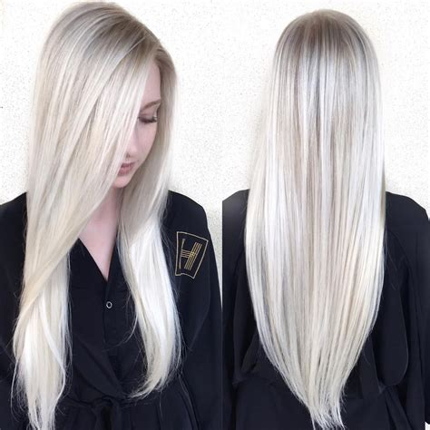 sleek platinum blonde hair  side part   cut
