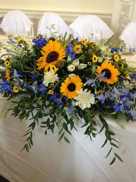 top table sunflowers scabious delphinium white hebe