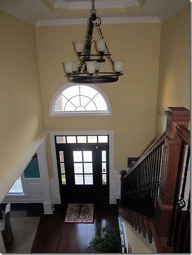 two story foyer pittsburgh paint belgian waffle butter yellow walls cherry hardwood