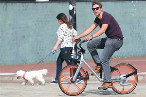 A Man Rides A Bike Operated By Mobike In Manchester The