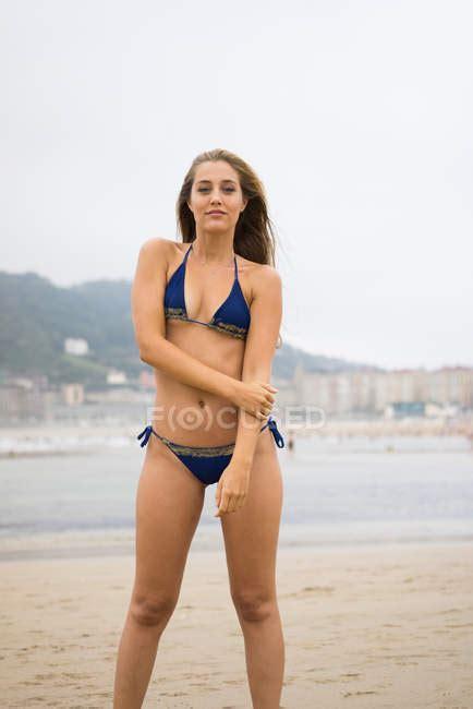 slim girl  blue bikini posing  beach idyllic body