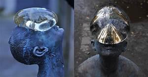 A giant glass raindrop balances on a bronze mans face in for A giant glass raindrop balances on a bronze mans face in ukraine