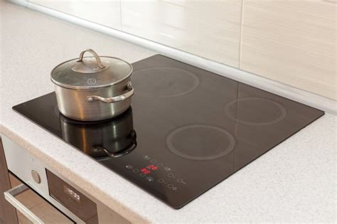 induction cooktop cooking stove glass ceramic cookware energy efficiency cracked repair kitchen chipped repaired stovetop modern magnets faq hunker pot