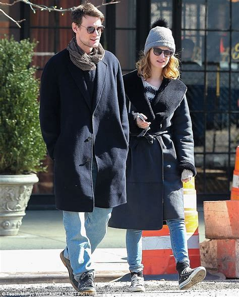 light blue cut up jeans lily james and matt smith don navy coats for new york city