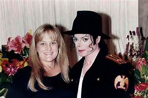 Michael Jackson and his second wife Debbie Rowe pose for a ...
