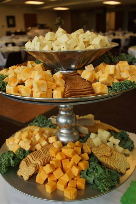tiered stand to display assorted cheese cubes and crackers for a summer wedding reception hi lo