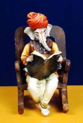 buy ganpatiji   wooden chair reading news paper