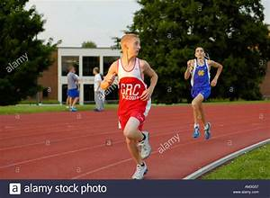 Teenage boy runners at a high school track and field ...