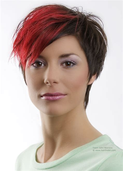 funky and steeply tapered short hairstyle with a red shock