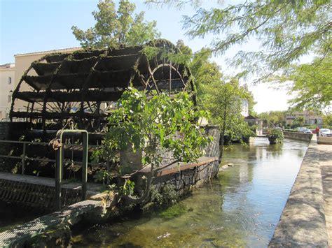 l water wheel file l isle sur la sorgue water wheel jpg wikimedia commons
