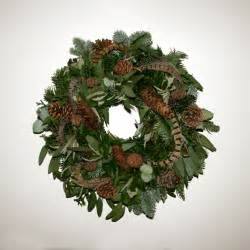 christmas wreath  pheasant feathers rose mary