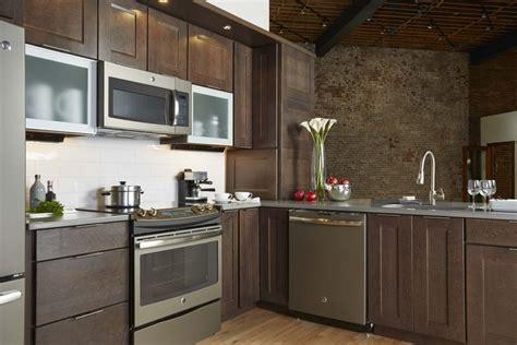stainless steel appliances meet aluminum cabinet doors