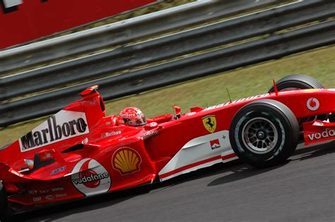 Driven by michael schumacher and rubens barrichello and designed by ross brawn and rory byrne, it was the most successful car in formula one history, achieving a total of 15 wins out of 18. Ferrari F1 2004 - Copyright JTetteroo   Language Solutions Inc.