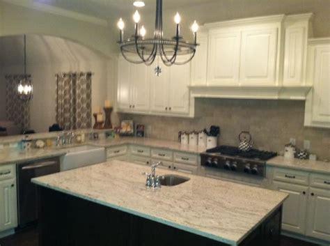 wood dover white cabinets white river granite kitchen