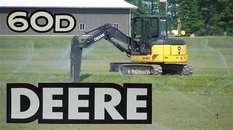 john deere  mini excavator ditching youtube