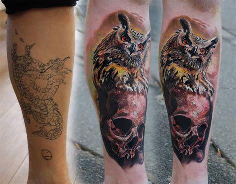 tatuaje brazo realista craneo buho por piranha tattoo supplies