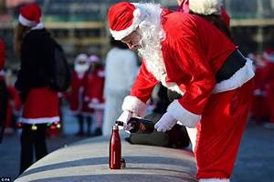 Hundreds of revellers turn out for Santacon in London ...