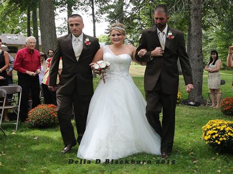 Dad Surprises Stepdad At Daughter's Wedding — With Both