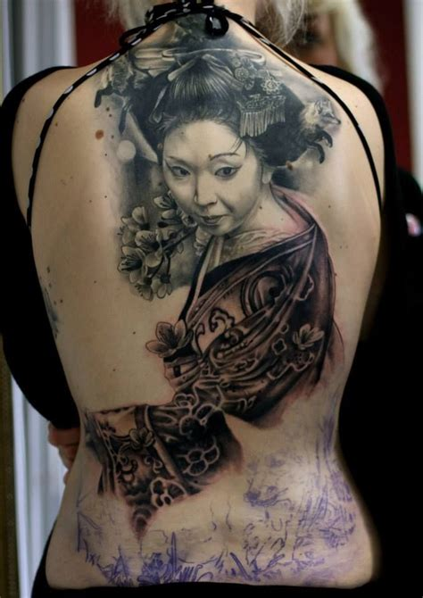 Lower Back Tattoo For Woman