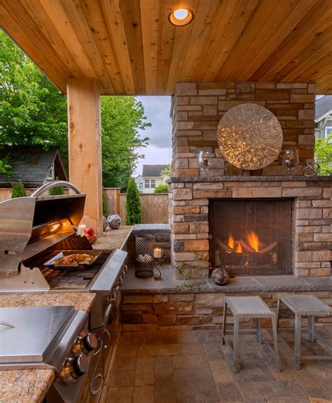 cozy outdoor kitchen and fireplace http www