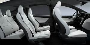 Tesla updates Model X with new front seats for more space and seat pockets - Electrek