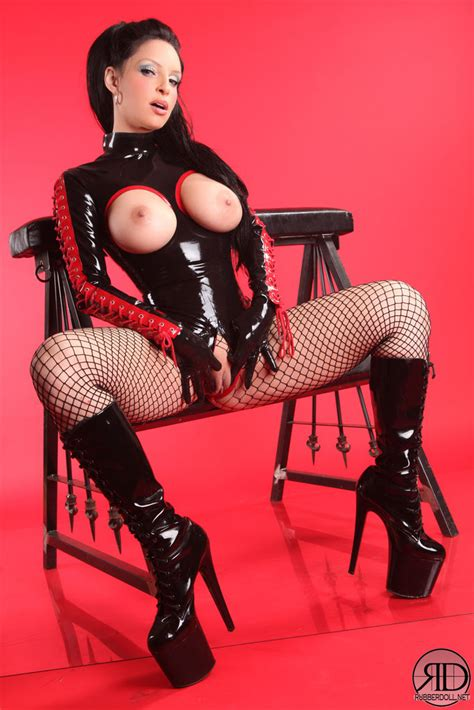 Rubberdoll Fingers Her Shaved Pussy Wearing Gloves